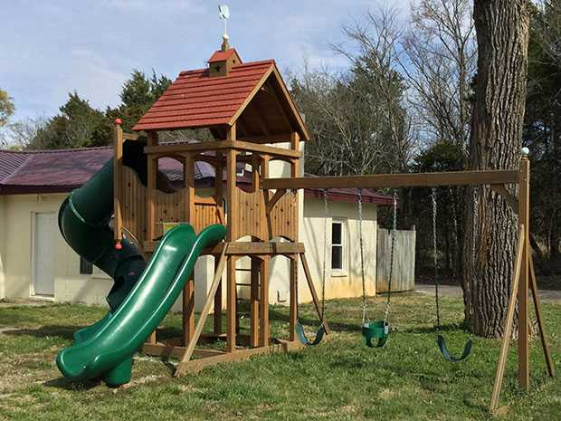 A custom playset with a tube slide, straight slide, and 3 position attachment