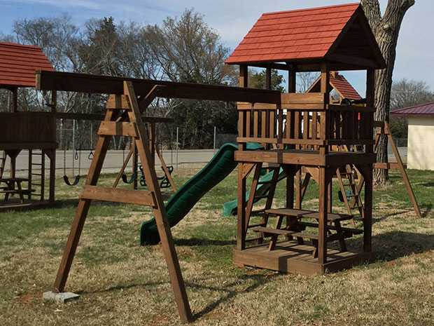 A Picnic Tower with a picnic table, slide, and 3 position attachment